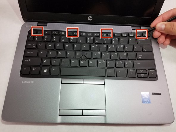 4 tabs are located at the top of the keyboard, which lock it in place.