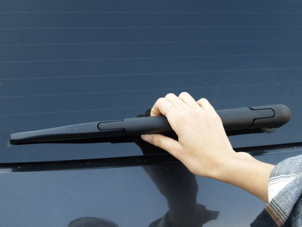 Gently lift the wiper off of the window to begin.