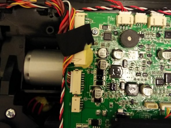 Flip the board to the other side to access the main brush motor