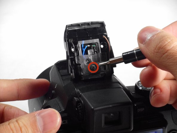 Using a Phillips #000 Precision Screwdriver, remove the 4.0 mm screw from the plastic cover.