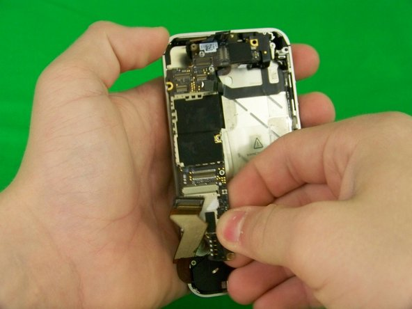 Using your fingers or a plastic opening tool carefully pull out the logic board.