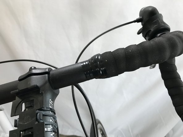 Optional: Wrap a few layers of electrical tape around the end of the handlebar tape at the middle of the bar to decrease the chances of the handlebar tape peeling off.