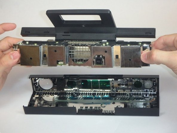 Remove the assembly from the case. You now have access to the inner shell of the kinect, along with the heat sink, microphone, and LED sensor.