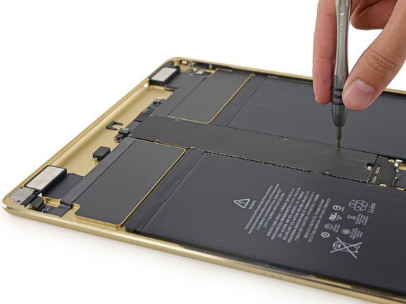 Here's a first in iPad history: we have to remove the logic board's EMI shielding to remove the logic board itself.