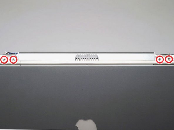Image 1/1: Position the display approximately at a 45 degree angle and rest the computer on a soft cloth with the back panel ports facing up.