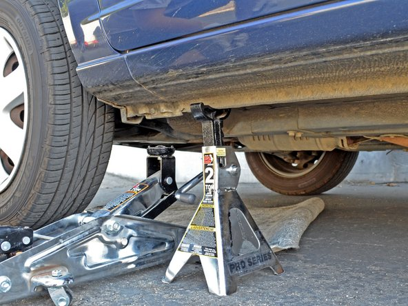 Image 3/3: '''Never''' work underneath a car that is resting only on a jack. The jack can slip or fail resulting in serious injury.
