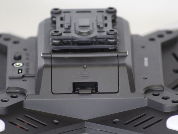 Locate the door to the battery compartment on the underside of the drone.