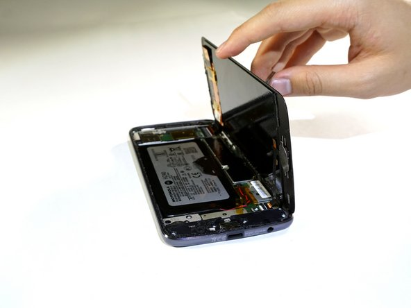Failure to lift screen from left to right can cause damage to interior wires of your phone.