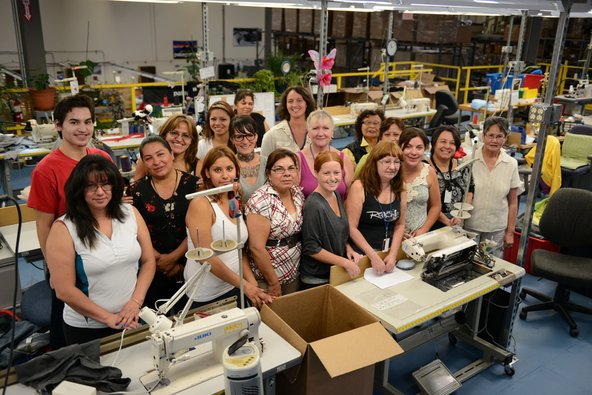 Delia the repair champion, with her team at the Patagonia warehouse