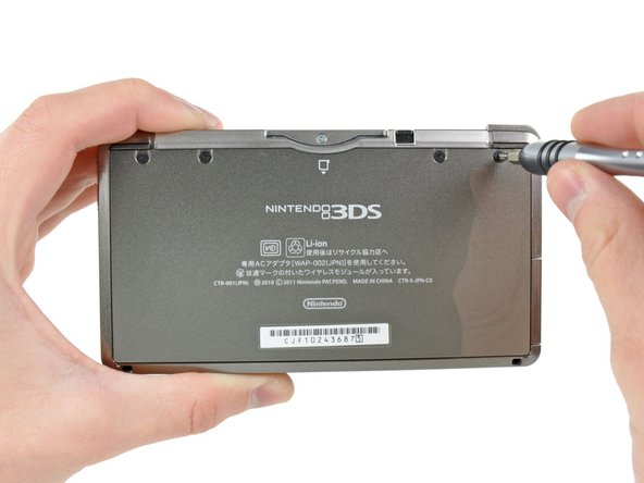 Image 1/1: Unlike [guide|2181|previous|stepid=11098] DS [guide|714|consoles|stepid=3768], the entire back cover of the 3DS comes off as one piece rather than having a small door to access the battery. This makes for a cleaner look, but also means that replacing the battery will take a little longer.