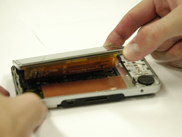 Image 3/3: The screen is still attached underneath with two ribbon cables.  Lift it very carefully.
