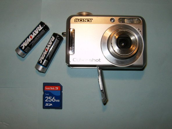 Open the compartment on the bottom of the camera. Remove the batteries and memory card.