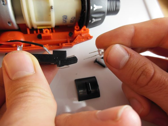 Take your new LED and slide it back into the plastic housing in the same orientation as the old LED.