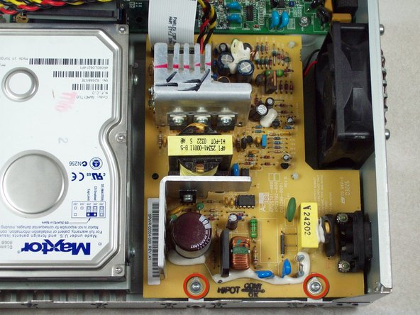 Remove the two 0.31 inch T-9 screws from the power supply.