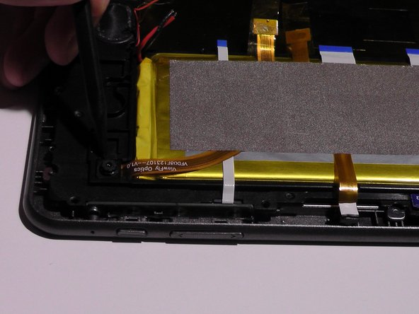 Image 2/3: Remove the silver tape from the battery.
