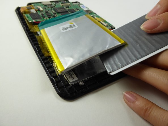 Use a plastic card to loosen the battery from the tablet. Note that it will be sticky underneath the battery.