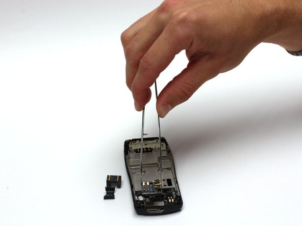 Use tweezers to remove the charging port.