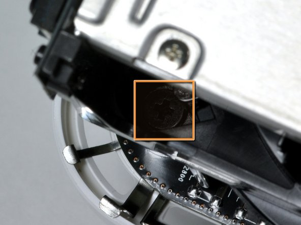 Remove the black Phillips screw from the top left corner. This particular screw is hidden from view.