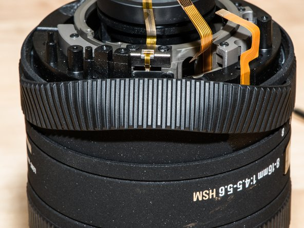 Remove the rubber grip around the zoom ring.