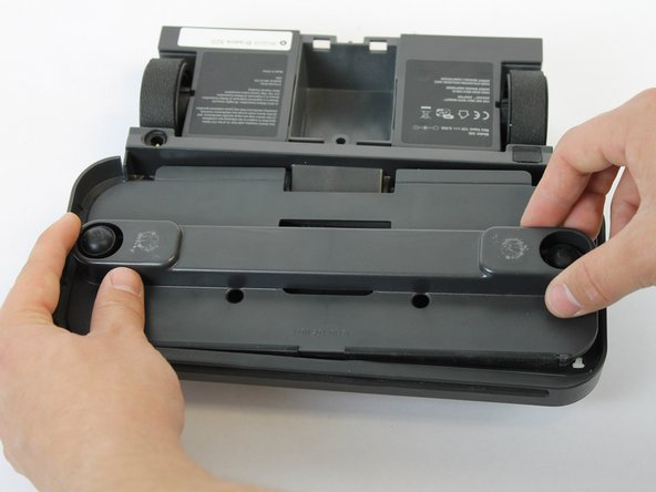 Flip the device over and remove the deck plate assembly cover by lifting it up.