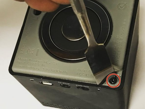 Use the J0 screwdriver to remove all four 10mm screws from the bottom of the speaker.