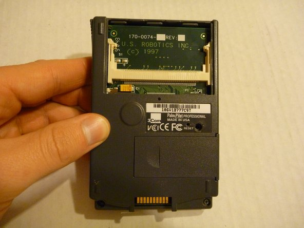 The card fits into the card slot located behind the cover. To remove the card just pull it out of the slot.