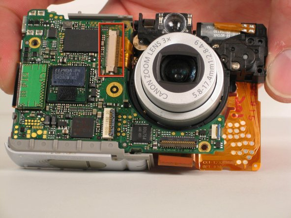 Locate the brown ZIF connector located on the front of the camera.
