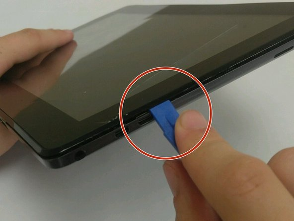 Insert the iFixit Opening Tool into the seam of the back tablet casing and gently pry upwards. With enough force the clips will release on the back tablet casing.