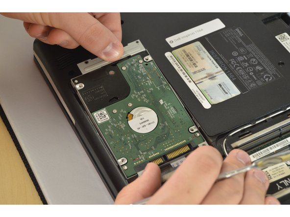 Slide the Hard Drive to the left to unplug it and gently pry upwards and pull away from device.
