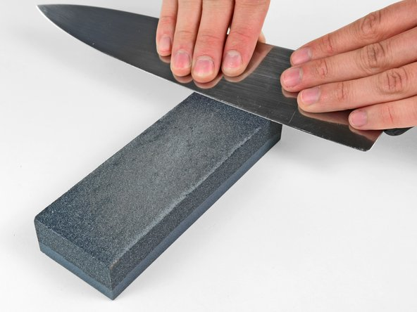 Once one side of the blade has been uniformly sharpened with the coarse grit, repeat the process to uniformly bevel the length of the cutting edge on the other side of the knife.