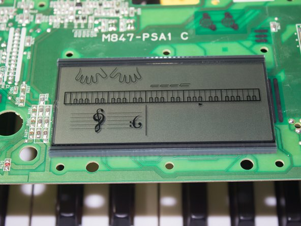 Flip over the component board to reveal the display that is currently connected to a green panel.