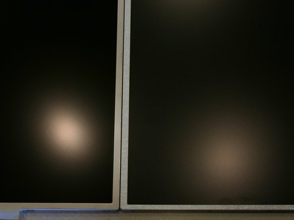 Image 1/1: The V.4 is slightly more reflective than the basic T520 display. The B156HW01 V.4 on the left makes a more focused reflection of the overhead light while the stock display (LG LP156WH4) creates a larger diffused reflection.