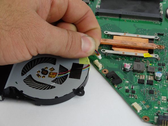 Remove fan part from the motherboard.