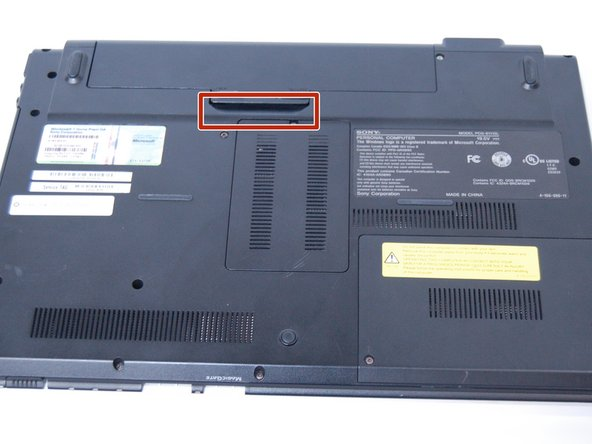 Use your  fingernail or a plastic tool to lift the battery. Rotate the battery up and away to remove from the laptop.