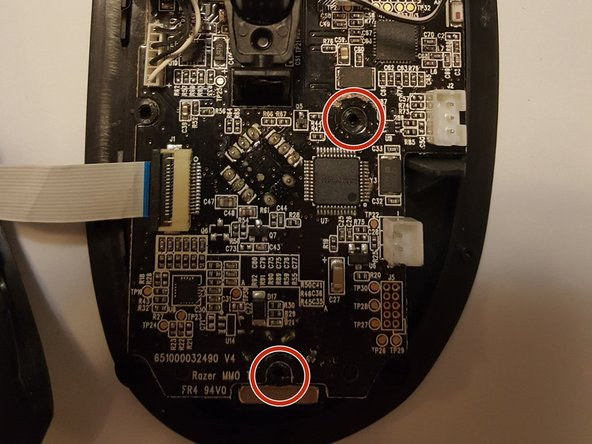 Remove the two screws that were on either side of the battery mount. This will allow the circuit board to be removed.