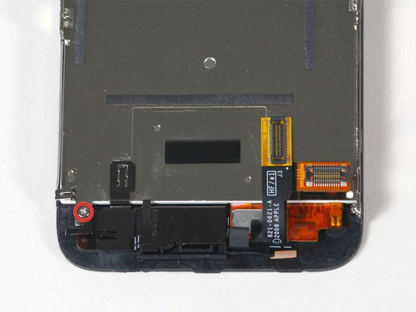Image 1/1: Remove the single Phillips #00 screw from the corner of the display assembly.