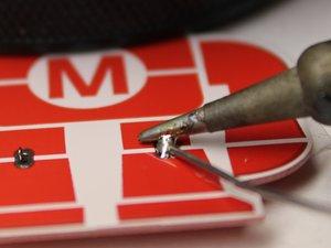 Learn to solder electronics with the Maker Shed Solder Badge!