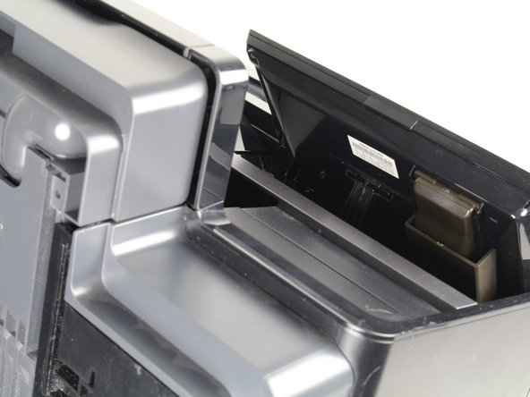 Place the printer on its back and rotate the display clockwise to gain access to the underside of the display.