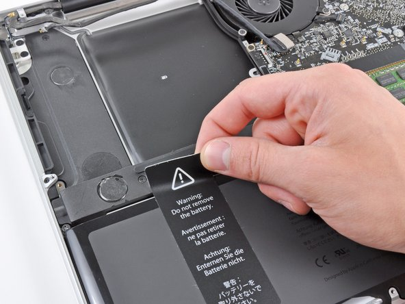 Image 2/2: Peel the sticker off the right speaker/subwoofer enclosure.