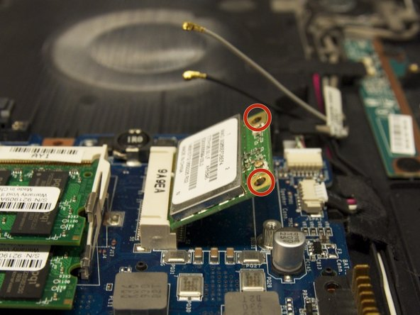 Remove the two Phillips 5.3mm screws from the network card.