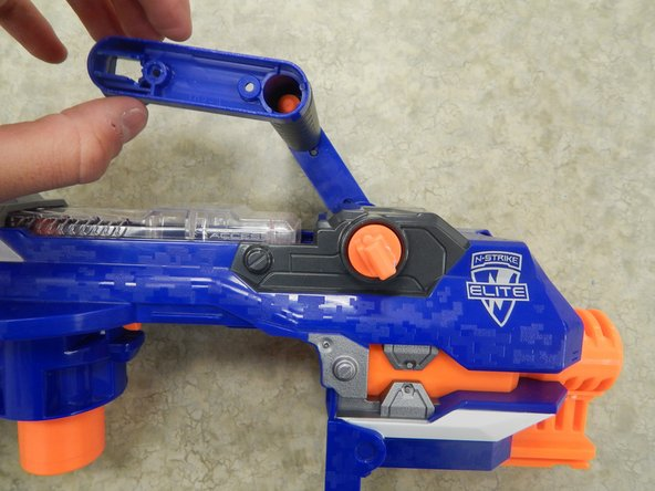 Image 3/3: Repeat the procedure on the other side to completely remove the handle from the rest of the Nerf Gun.