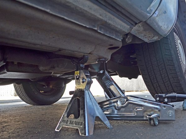 Place the jack on the frame and raise the car until it is no longer resting on the jack stand.