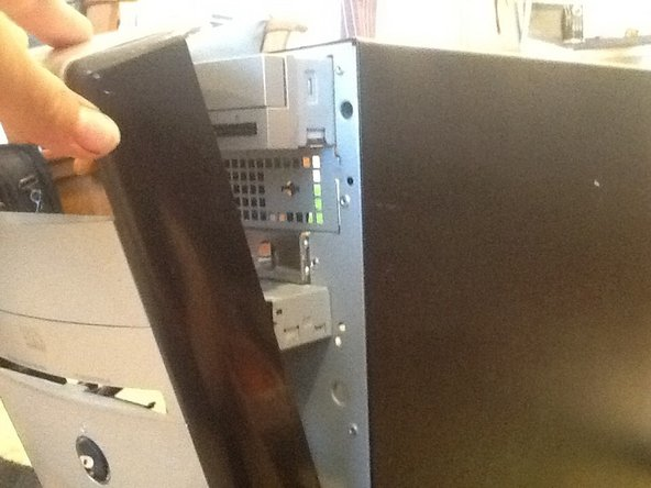 Image 2/3: Don't pull it out too hard, as there are three cables still connected to the panel.