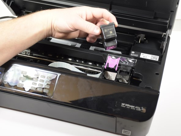 Lift the tab to remove the cartridge.