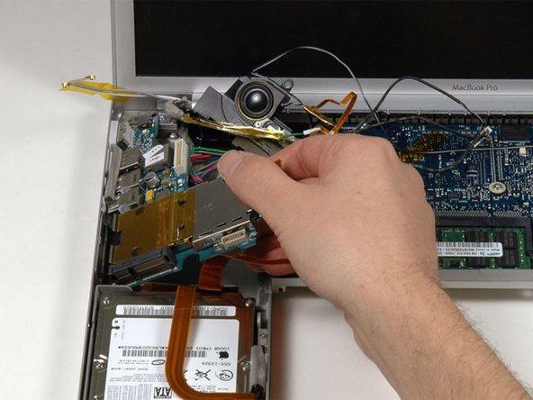 Image 1/1: Lift up the right side of the left I/O board and slide it out of the computer.