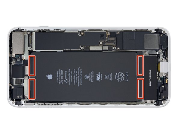 The iPhone 8's battery is secured by four pieces of stretch-release adhesive—two at the top, and two at the bottom.