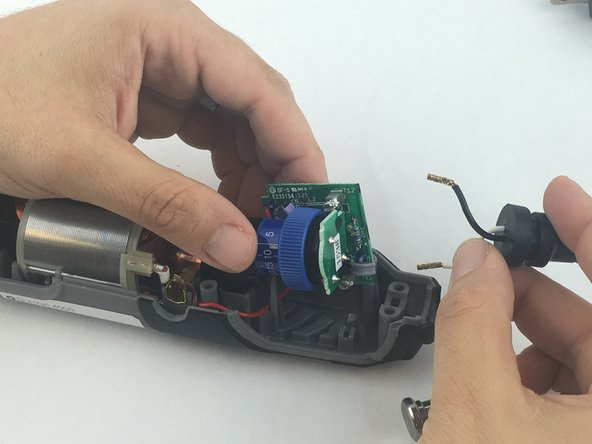 Carefully remove both wires from circuit board with your hands.