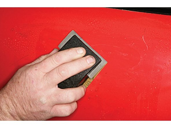 Block sand the panel with 2000-grit wet/dry sandpaper and plenty of water. Sand until the shoe polish disappears.