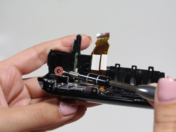 Remove one more 5mm screw below the power button.