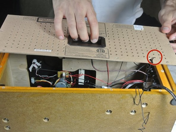Image 3/3: Remove the antenna wire from the line out port, then remove the line out port and set it aside.